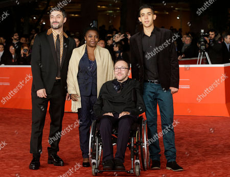 Stock Photo of Filippo Timi, Jaouher Brahim, Mirko Locatelli, Cecile Kyenge Actors Filippo Timi, left, Jaouher Brahim, right, director Mirko Locatelli, second from right, and Italian Minister for Integration Cecile Kyenge pose for photographers during the red carpet for the movie 'I Corpi Estranei', at the 8th edition of the Rome International Film Festival, in Rome, . (AP Photo