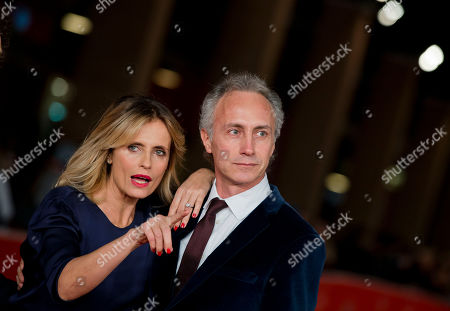 Marco Travaglio, Isabella Ferrari Actress Isabella Ferrari pose with Italian journalist Marco Travaglio on the red carpet as they arrive for the screening of the movie 'Il venditore di medicine' at the 8th edition of the Rome International Film Festival in Rome