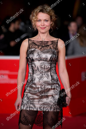 Actress Helle Fagralid poses on the red carpet as she arrives for the screening of the movie 'Sorrow and joy', at the 8th edition of the Rome International Film Festival, in Rome