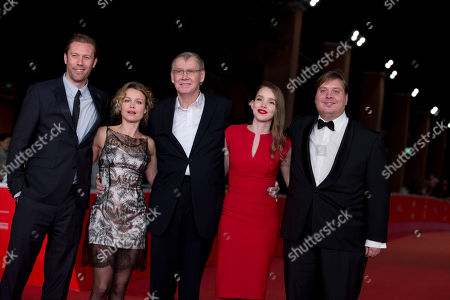 Stock Photo of From left, actors Jakob Cedergren and Helle Fagralid, director Nils Malmros, and actors Maja Dybboe and Nicolas Bro pose on the red carpet as they arrive for the screening of the movie 'Sorrow and joy', at the 8th edition of the Rome International Film Festival, in Rome