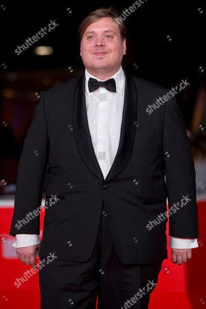 Stock Picture of Actor Nicolas Bro poses on the red carpet as he arrives for the screening of the movie 'Sorrow and joy', at the 8th edition of the Rome International Film Festival, in Rome