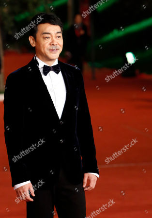 "Sean Lau Actor Sean Lau poses for photographers on the red carpet for the screening of his movie ""Saodu"" (The White Storm) at the 8th edition of the Rome International Film Festival in Rome"