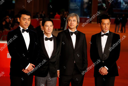 "Louis Koo, Benny Chan, Sean Lau, Nick Cheung Director Benny Chan, second from right, poses for photographers on the red carpet with actors, from left, Sean Lau, Nick Cheung and Louis Koo, right, for the screening of his movie ""Saodu"" (The White Storm) at the 8th edition of the Rome International Film Festival in Rome"