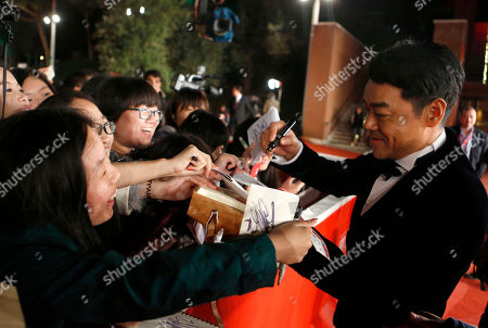 "Sean Lau Actor Sean Lau signs autographs on the red carpet for the screening of his movie ""Saodu"" (The White Storm) at the 8th edition of the Rome International Film Festival in Rome"