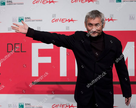 Tsui Hark Director Tsui Hark poses during the photo call of his movie 'Di Renjie Shendu Longwang' (Young Detective Dee: Rise of the Sea Dragon) at the 8th edition of the Rome International Film Festival in Rome