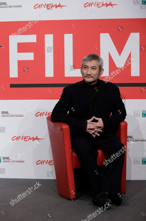 Stock Picture of Tsui Hark Director Tsui Hark poses during the photo call of his movie 'Di Renjie Shendu Longwang' (Young Detective Dee: Rise of the Sea Dragon) at the 8th edition of the Rome International Film Festival in Rome