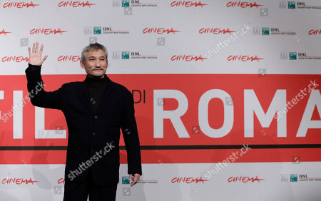Stock Photo of Tsui Hark Director Tsui Hark poses during the photo call of his movie 'Di Renjie Shendu Longwang' (Young Detective Dee: Rise of the Sea Dragon) at the 8th edition of the Rome International Film Festival in Rome