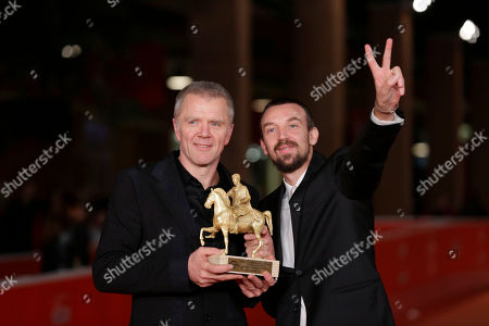 Director Alberto Fasulo, right, flanked by actor Branko Zavrsan holds the Golden Marc'Aurelio Award for Best Film 'Tir' as he poses for photographers at the 8th edition of the Rome International Film Festival, in Rome