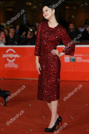 Actress Ni Hongjie poses for photographers at the 8th edition of the Rome International Film Festival in Rome, . Director Cui Jian was awarded Saturday the special Marc'Aurelio Jury Award for the movie 'Blue Sky Bones