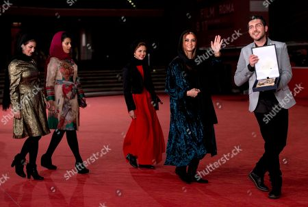 Stock Photo of From left, actors Nawal Sharipi, Kiarash Asadizadeh, Mahsa Alafar, Roya Javidnia and Mohammadreza Ghaffari, pose for photographers with the Award for Emerging Actor and Actress for the movie ' Acrid ' at the 8th edition of the Rome International Film Festival in Rome