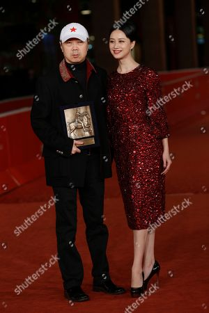 Director Cui Jian, left, holding the special Marc'Aurelio Jury Award for the movie 'Blue Sky Bones', and actress Ni Hongjie pose for photographers at the 8th edition of the Rome International Film Festival in Rome