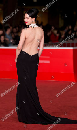 Actress Ni Hongjie waves to fans as she arrives for the awarding ceremony of the 8th edition of the Rome International Film Festival in Rome