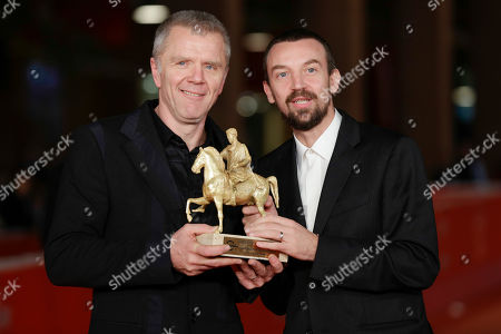 Stock Photo of Director Alberto Fasulo, right, and actor Branko Zavrsan hold the Golden Marc'Aurelio Award for Best Film 'Tir' as they pose for photographers at the 8th edition of the Rome International Film Festival, in Rome