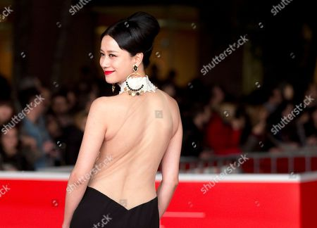 Actress Ni Hongjie poses for photographers as she arrives for the awarding ceremony of the 8th edition of the Rome International Film Festival in Rome