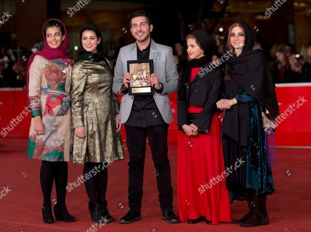 From left, actors Kiarash Asadizadeh, Nawal Sharipi, Mohammadreza Ghaffari, Mahsa Alafar and Roya Javidnia pose for photographers with the Award for Emerging Actor or Actress for the movie ' Acrid ' at the 8th edition of the Rome International Film Festival, in Rome