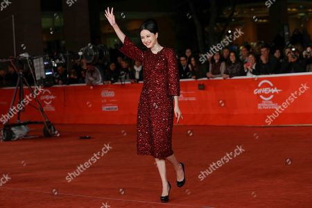 Actress Ni Hongjie waves as she poses for photographers at the 8th edition of the Rome International Film Festival in Rome, . Director Cui Jian was awarded Saturday the special Marc'Aurelio Jury Award for the movie 'Blue Sky Bones