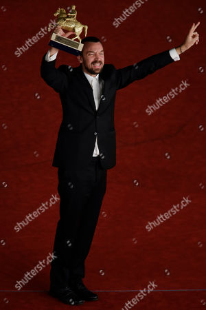 Director Alberto Fasulo holds the Golden Marc'Aurelio Award for Best Film 'Tir' as he poses for photographers at the 8th edition of the Rome International Film Festival, in Rome