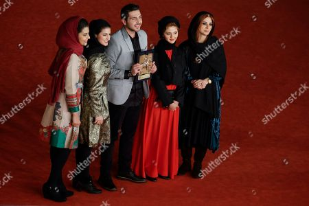 Stock Image of From left, actors Kiarash Asadizadeh, Nawal Sharipi, Mohammadreza Ghaffari, Mahsa Alafar and Roya Javidnia pose for photographers with the Award for Emerging Actor or Actress for the movie ' Acrid ' at the 8th edition of the Rome International Film Festival, in Rome