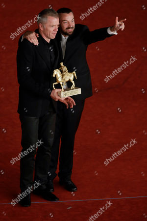 Director Alberto Fasulo, right, and actor Branko Zavrsan pose for photographers with the Golden Marc'Aurelio Award for Best Movie ' Tir ' at the 8th edition of the Rome International Film Festival, in Rome