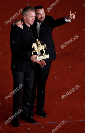 Director Alberto Fasulo, right, and actor Branko Zavrsanhold pose for photographers with the Golden Marc'Aurelio Award for Best Movie ' Tir ' at the 8th edition of the Rome International Film Festival, in Rome