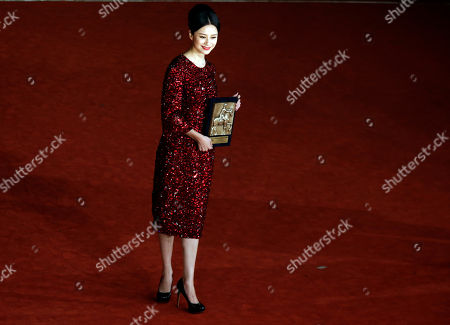 Actress Ni Hongjie poses for photographers with the Special Mention prize for the movie 'Lanse gutou' (Blue Sky Bones) at the 8th edition of the Rome International Film Festival, in Rome