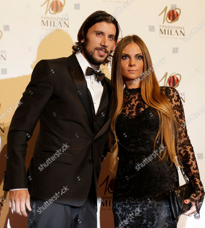AC Milan defender Cristian Zaccardo is flanked by his wife Alessia as they attend the 'Foundation Milan', 10 years anniversary party in Milan, Italy, . Milan Foundation is a public charity that is tied to the Milan Group's wider context of responsibility and sustainability