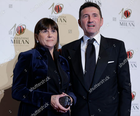 AC Milan former player Giovanni Galli is flanked by his wife Anna as they attend the 'Foundation Milan', 10 years anniversary party in Milan, Italy, . Milan Foundation is a public charity that is tied to the Milan Group's wider context of responsibility and sustainability
