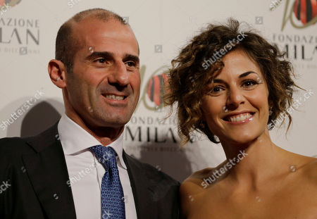 Stock Picture of Italian former soccer player Giuseppe Pancaro is flanked by his wife Vincenza Cacace as they attend the 'Foundation Milan', 10 years anniversary party in Milan, Italy, . Milan Foundation is a public charity that is tied to the Milan Group's wider context of responsibility and sustainability