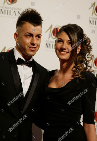 Stock Image of AC Milan forward Stephan El Shaarawy is flanked by his partner Ester Giordano as they attend the 'Foundation Milan', 10 years anniversary party in Milan, Italy, . Milan Foundation is a public charity that is tied to the Milan Group's wider context of responsibility and sustainability