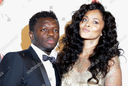 Stock Picture of AC Milan midfielder Sulley Muntari, of Ghana, is flanked by his wife Menaye Donkor as they attend the 'Foundation Milan', 10 years anniversary party in Milan, Italy, . Milan Foundation is a public charity that is tied to the Milan Group's wider context of responsibility and sustainability