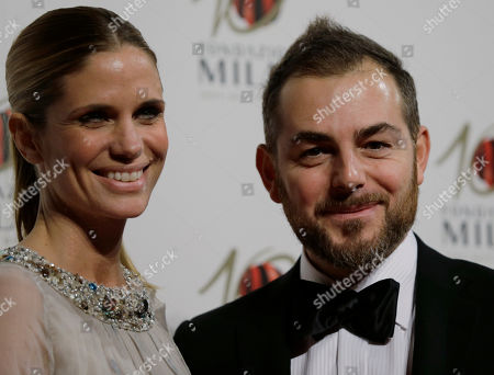 Filippa Lagerback is flanked by her partner Daniele Bossari as they attend the 'Foundation Milan', 10 years anniversary party in Milan, Italy, . Milan Foundation is a public charity that is tied to the Milan Group's wider context of responsibility and sustainability