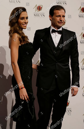 Stock Picture of AC Milan coach Massimiliano Allegri is flanked by his partner Gloria Patrizi as they attend the 'Foundation Milan', 10 years anniversary party in Milan, Italy, . Milan Foundation is a public charity that is tied to the Milan Group's wider context of responsibility and sustainability