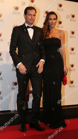 Stock Image of AC Milan coach Massimiliano Allegri is flanked by his partner Gloria Patrizi as they attend the 'Foundation Milan', 10 years anniversary party in Milan, Italy, . Milan Foundation is a public charity that is tied to the Milan Group's wider context of responsibility and sustainability