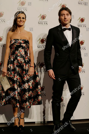 AC Milan midfielder Riccardo Montolivo is flanked by his partner model Cristina De Pin as they attend the 'Foundation Milan', 10 years anniversary party in Milan, Italy, . Milan Foundation is a public charity that is tied to the Milan Group's wider context of responsibility and sustainability