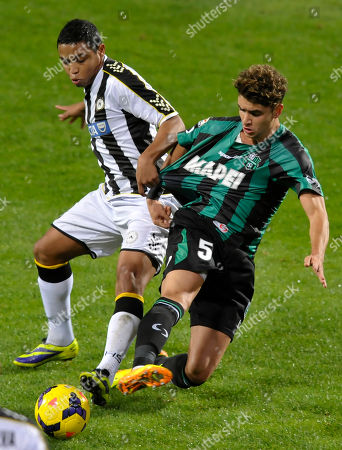 Sassuolo's Luca Antei, right, competes for the ball with Udinese's Luis Fernando Muriel of Colombia, during their Serie A soccer match at Reggio Emilia's Mapei stadium, Italy
