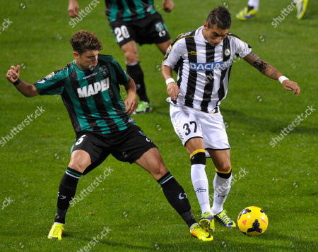 Sassuolo's Luca Antei, left, vies for the ball with Udinese's Roberto Pereyra of Argentina, during their Serie A soccer match at Reggio Emilia's Mapei stadium, Italy