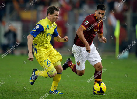 Stock Photo of AS Roma forward Marco Borriello, right, and Chievo defender Sebastien Frey of France go for the ball during a Serie A soccer match between AS Roma and Chievo, at Rome's Olympic stadium