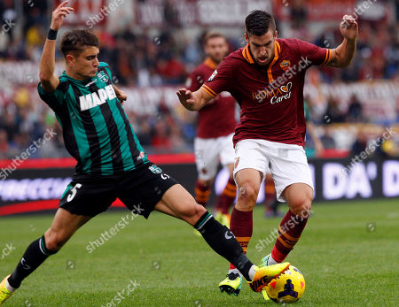 Luca Antei Kevin Strootman Sassuolo defender Luca Antei, left, and AS Roma midfielder Kevin Strootman, of the Netherlands, fight for the ball during a Serie A soccer match between AS Roma and Sassuolo at Rome's Olympic stadium