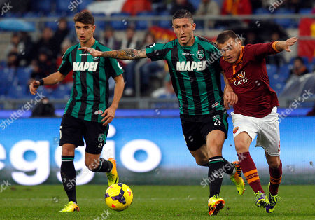 Luca Antei Luca Marrone Adem Ljajic Sassuolo midfielder Luca Marrone, center, and AS Roma forward Adem Ljajic, of Serbia, right, fight for the ball during a Serie A soccer match between AS Roma and Sassuolo at Rome's Olympic stadium