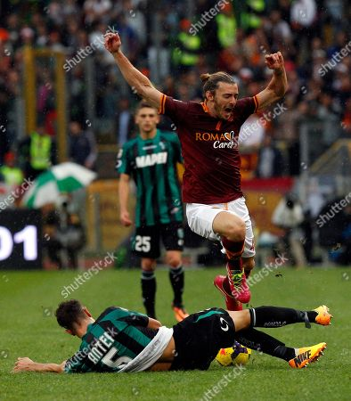 Luca Antei, Federico Balzaretti AS Roma defender Federico Balzaretti is tackled by Sassuolo defender Luca Antei, bottom, during a Serie A soccer match between AS Roma and Sassuolo at Rome's Olympic stadium