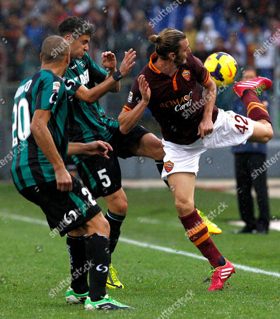 Paolo Bianco Luca Antei Federico Balzaretti AS Roma defender Federico Balzaretti, right, is challenged by Sassuolo defenders Luca Antei, center, and Paolo Bianco, during a Serie A soccer match between AS Roma and Sassuolo at Rome's Olympic stadium