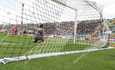 Udinese's Antonio Di Natale, scores past Cagliari goalkeeper Michael Agazzi, during the Serie A soccer match between Udinese and Cagliari, at the Friuli Stadium in Udine, Italy