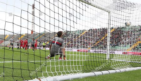 Udinese's Antonio Di Natale scores past Cagliari goalkeeper Michael Agazzi, during the Serie A soccer match between Udinese and Cagliari, at the Friuli Stadium in Udine, Italy