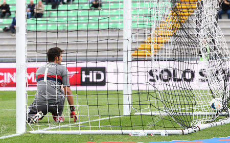 Stock Image of Cagliari goalkeeper Michael Agazzi watches the ball heading into the net after Udinese striker Antonio di Natale scored, during the Serie A soccer match between Udinese and Cagliari, at the Friuli Stadium in Udine, Italy