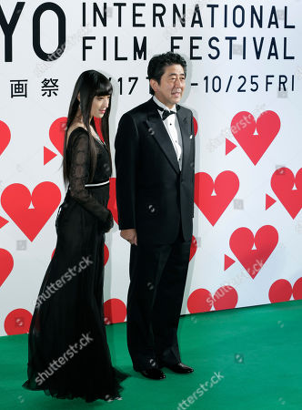 Shinzo Abe, Chiaki Kuriyama Japanese Prime Minister Shinzo Abe, right, and Festival Muse Chiaki Kuriyama pose on the green carpet as they arrive for the opening ceremony of the 26th Tokyo International Film Festival in Tokyo