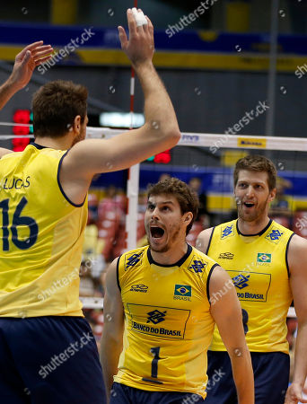 Lucas Saatkamp, Bruno Mossa Rezende, Eder Carbonera Brazilian volleyball team members Lucas Saatkamp (16), Bruno Mossa Rezende (1) and Eder Carbonera celebrate after winning over Italy during their match in the men's volleyball World Grand Champions Cup in Tokyo