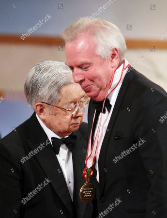 Hitachi, Antony Gormley British sculptor Antony Gormley, left, leaves the stage after he was presented with a medal for his achievements by Prince Hitachi, left, during an award presentation ceremony for the 25th Praemium Imperiale culture awards in Tokyo
