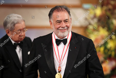 Hitachi, Francis Ford Coppola American film director Francis Ford Coppola leaves the stage after he was presented a medal for his achievement by Prince Hitachi, left, during an award presentation ceremony for the 25th Praemium Imperiale culture award in Tokyo