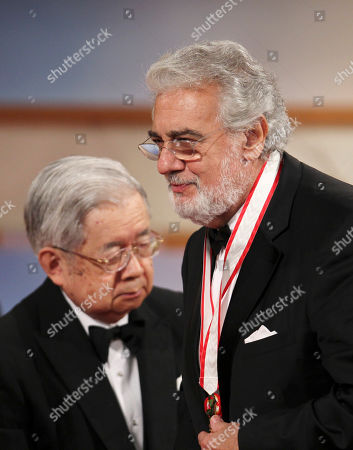 Hitachi, Placido Domingo Spanish tenor Placido Domingo leaves the stage after he was presented a medal for his achievement by Prince Hitachi, left, during an award presentation ceremony for the 25th Praemium Imperiale culture award in Tokyo