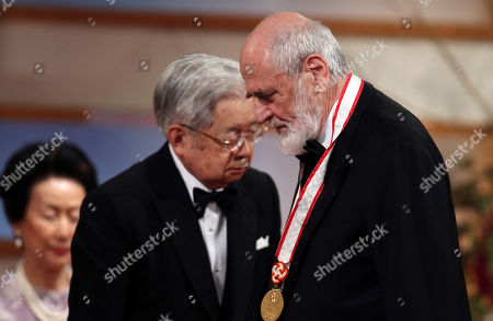Michelangelo Pistoletto, Hitachi Italian painter Michelangelo Pistoletto, left, leaves the stage after he was presented with a medal for his achievements by Prince Hitachi, center, during an award presentation ceremony for the 25th Praemium Imperiale culture awards in Tokyo